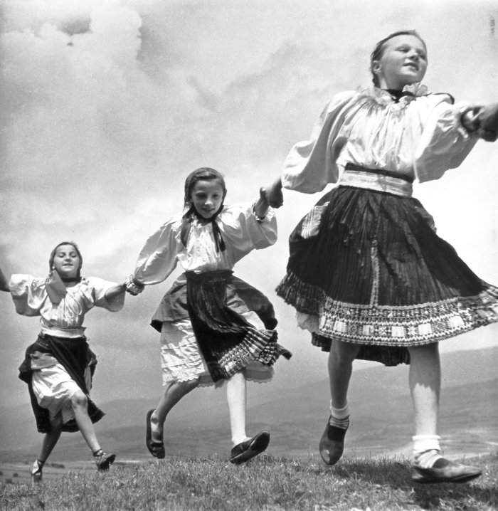 Bohemian-girls-in-ethnic-folk-dress-playing