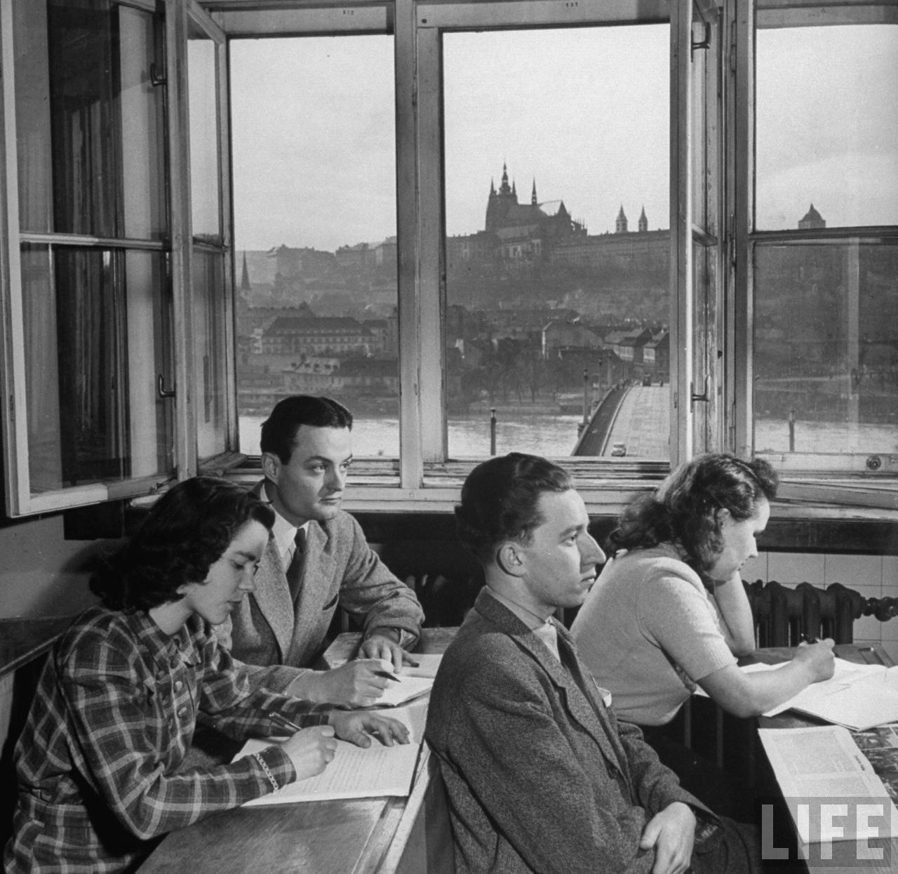 John Skrivanek (Rear L) of Austin,Texas, with fellow students in classroom of philosophy building of Charles University on banks of the Vltava River overlooking ancient Hradcany castle and St. Vitus Cathedral.