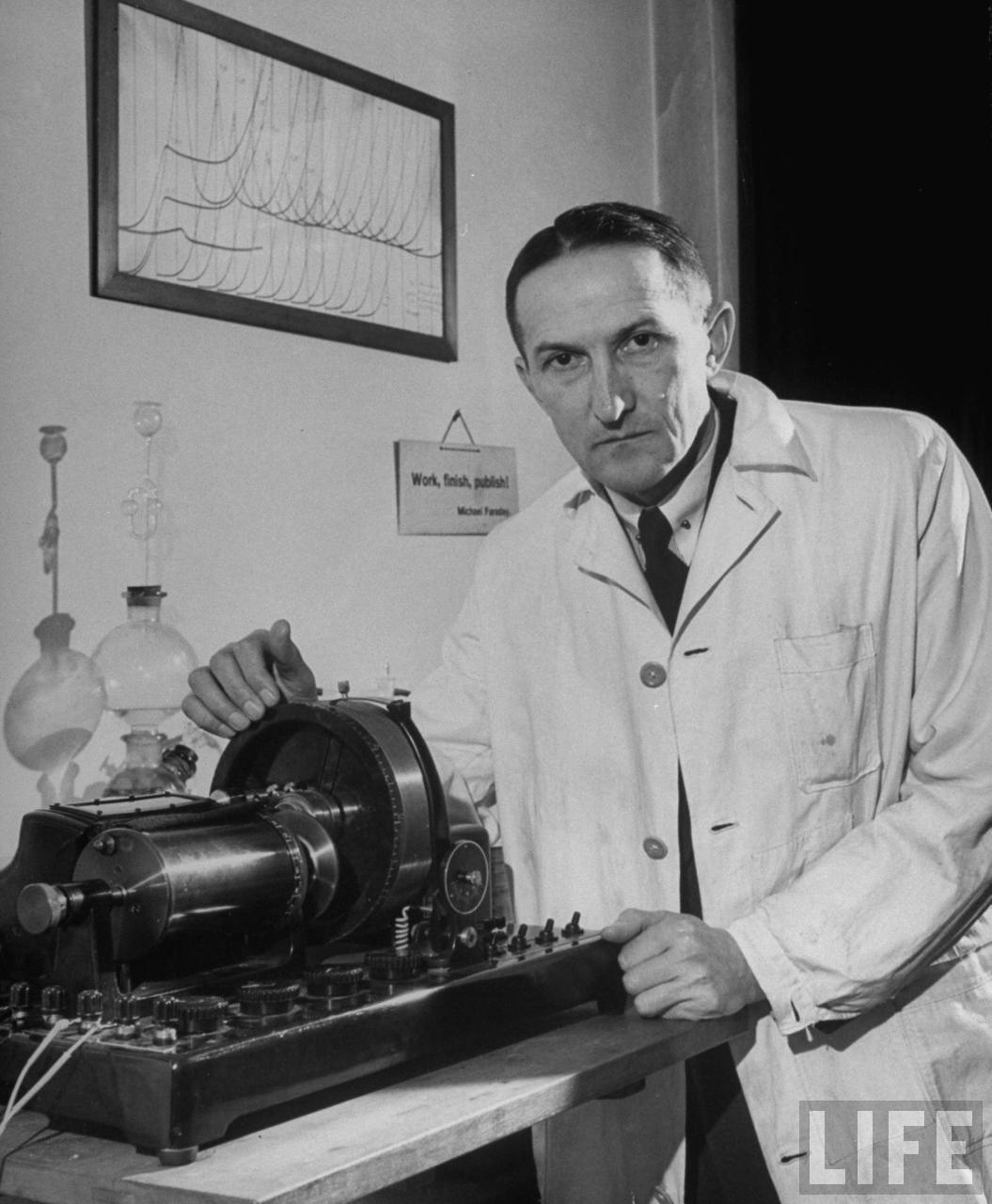 Portrait of Dr. Jaroslav Heyrovsky, head of Physical Chemistry at Charles University, with his invention the polarograph, a device for the microanalysis of various solutions used in medicine, metallurgy, food study and other branches of science.