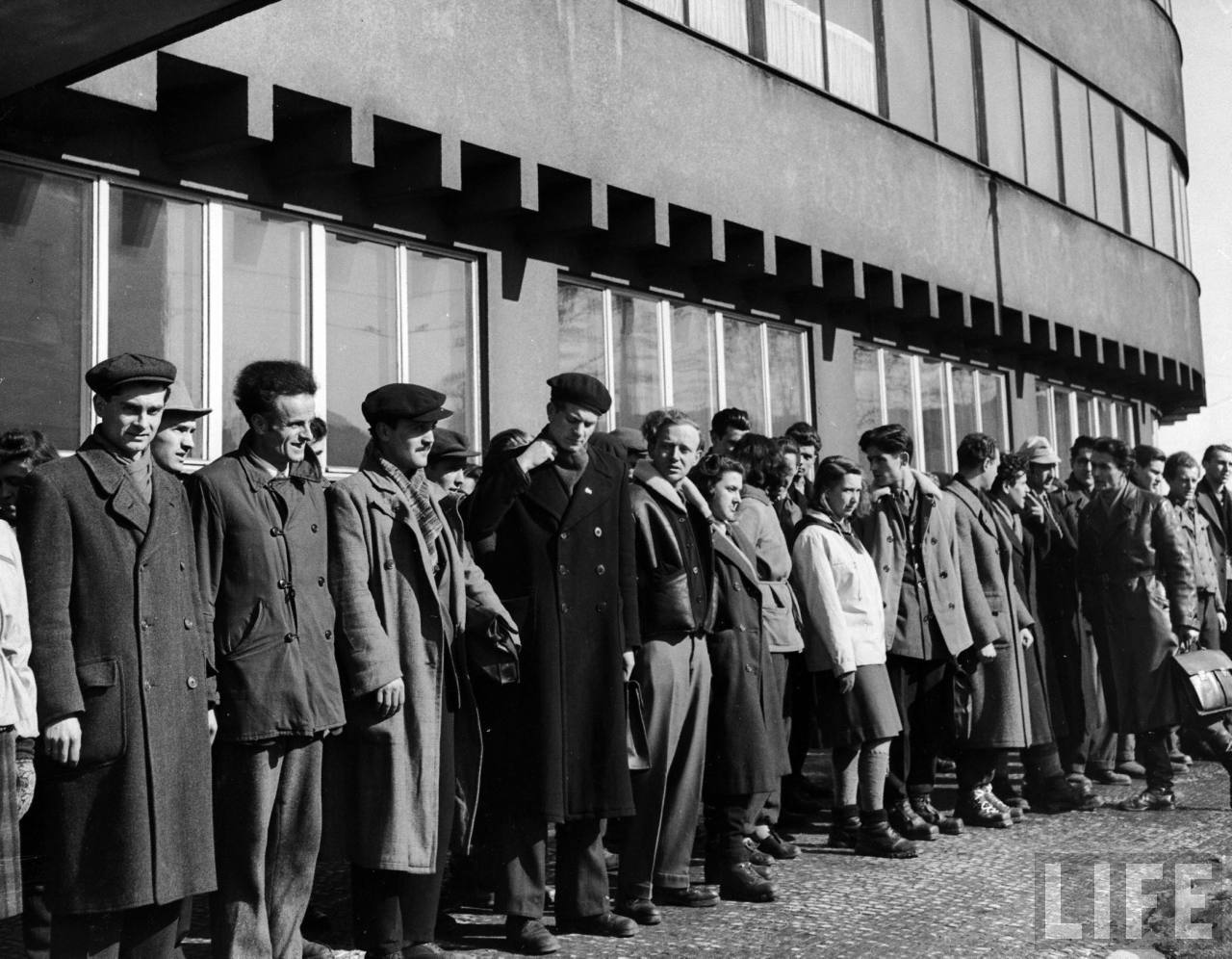 Yugoslavian students at Charles University lining up outside Marshal Tito Hall before going away on weekend to aid in winter coal crisis.