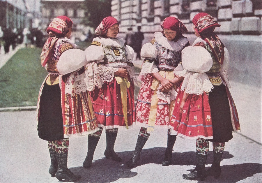 YOUNG WIVES OF SARDICE COME TO TOWN IN EMBROIDERED STOCKINGS, PIERCED BOOTS, AND STUFFED SLEEVES.
