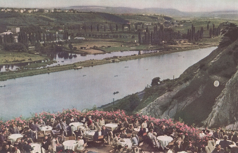 SIDE-WHEELERS FLYING THE VLTAVA. BRING HOLIDAY CROWDS FROM PRAHA TO THE ROSE-FRINGED TERRACES OF BARRANDOV.